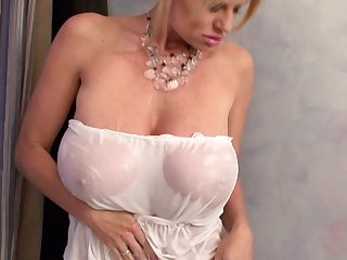 Kelly Madison enjoys a bath and a fellow's huge dong