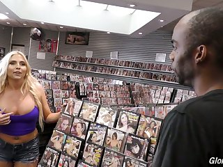 Whorish blonde with big boobs Christie Stevens goes wild in the glory hole room