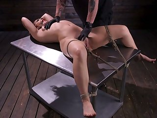 Tied up with an increment of restrained hooker Kimber Countryside is punished with vibrator