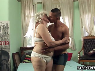 Granny Norma takes young boy's fixed cock