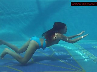Elegant redhead gets naked for skinny dipping fun