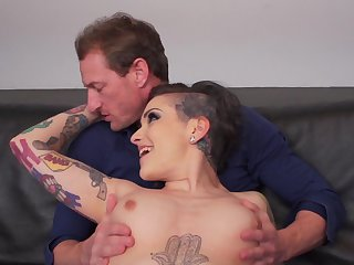 Tattooed model Rizzo Ford gives a blowjob before obtaining fucked